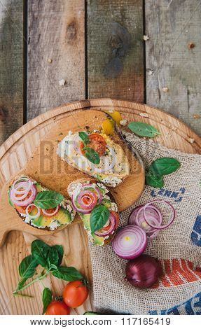delicious sandwiches on wooden tablet light
