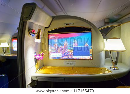 DUBAI, UAE - MARCH 31, 2015: interior of Emirates first class suite. Emirates is one of two flag carriers of the United Arab Emirates along with Etihad Airways and is based in Dubai.