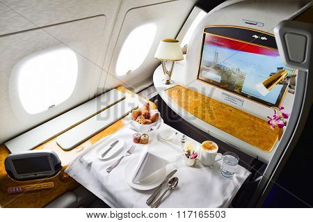 DUBAI, UAE - MARCH 31, 2015: Emirates Airbus A380 interior. Emirates is one of two flag carriers of the United Arab Emirates along with Etihad Airways and is based in Dubai.