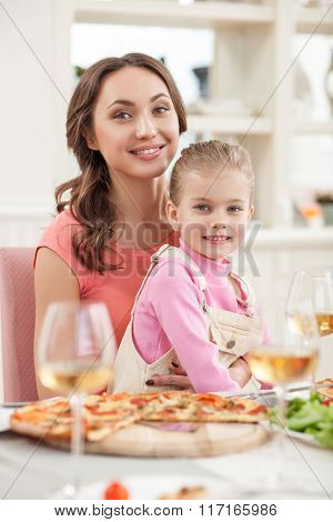 Cheerful friendly family has a dinner