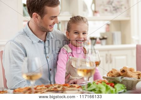 Cute man is dining with his child