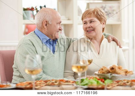 Pretty old husband and wife have a lunch