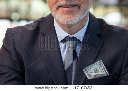 Cheerful mature man with great amount of money