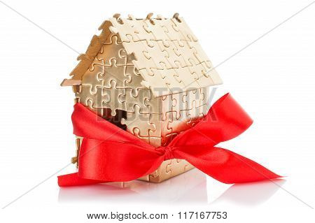 house of gold color puzzles with red bow