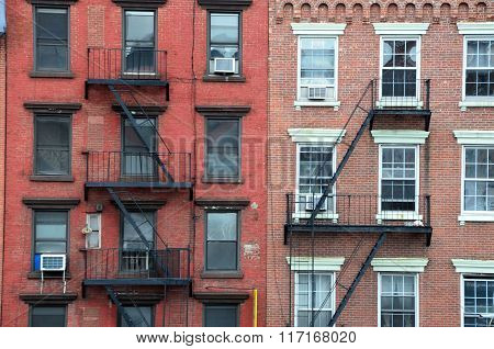 Buildings with fire escapes in New York City.