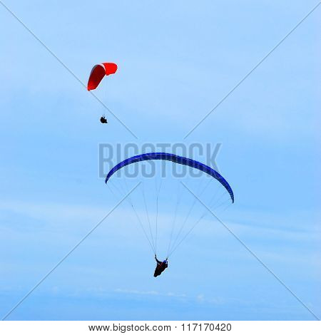 Two paragliders in the air