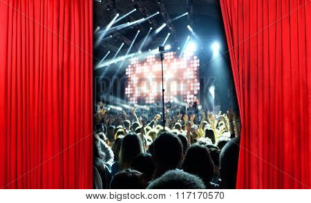 Red curtain on concert stage slightly open