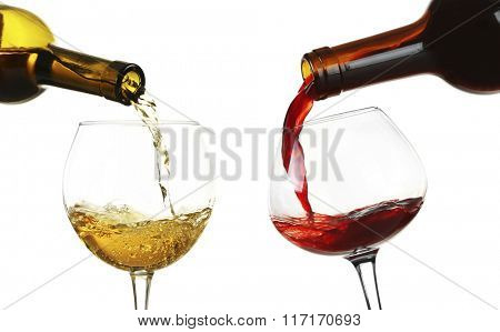 White and red wine pouring in glasses, isolated on white