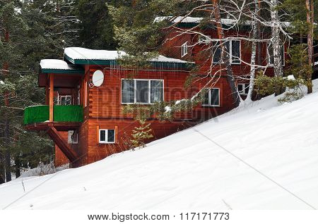 The Big Wooden House On The Mountain In Winter Time.