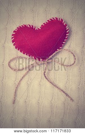 Textile red heart on a knitted texture
