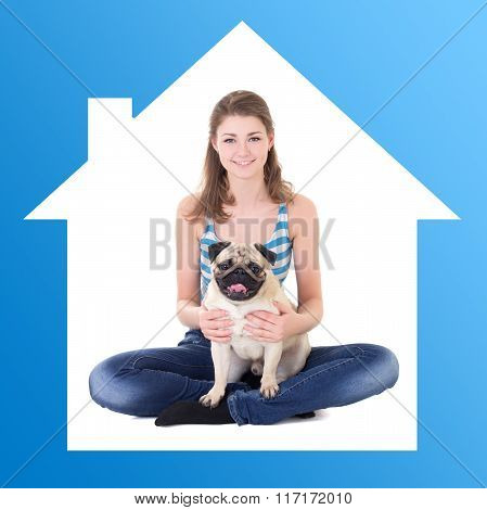 Home Concept - Beautiful Woman Holding Pug Dog In Blue House Frame