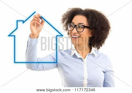 Real Estate Concept - Beautiful African American Business Woman Drawing House Over White