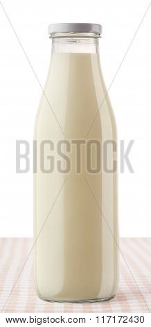 Closed Bottle Of Milk On Checkered Tablecloth