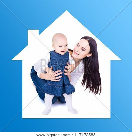 Home Concept - Young Mother Playing With Baby Girl