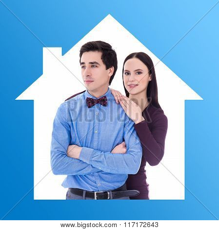 Relationship And Home Concept - Portrait Of Young Pretty Couple In Blue Frame