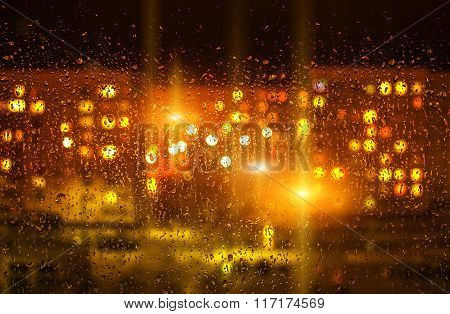 Drops Of Water On Window Glass After Rain, With Blurred Lights