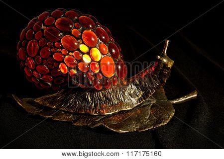 Handmade lamp snail shape made of bronze and amber