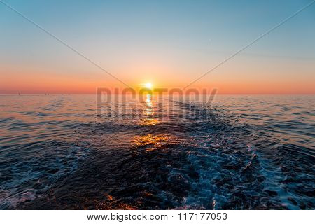 Sea Sunset With Ship Trace