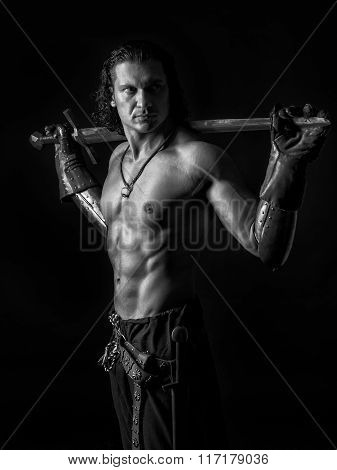 Half Naked Man With A Sword In Medieval Clothes