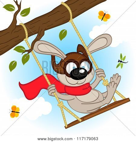 rabbit on swing on tree branch