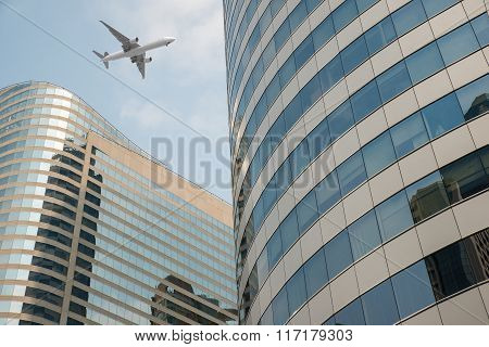 Shot Of Airplane Flying Above Skyscrapers In City Of Bangkok Downtown