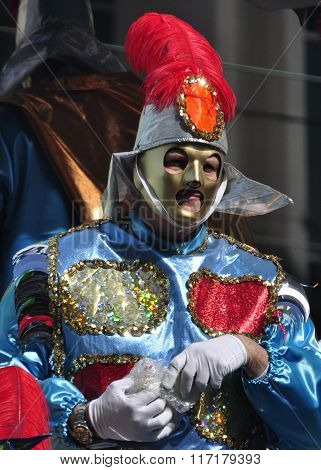 NEW ORLEANS - FEBRUARY 17, 2015: A masker riding a parade float during Mardi Gras throws beads