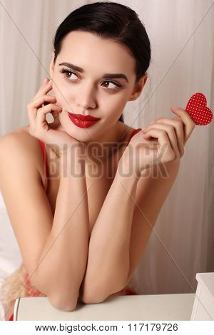Sexy Girl With Dark Hair Wears Elegant Lace Lingerie, Holding Red Heart