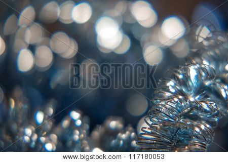 Background for text in gray color. Defocused lights and decoration on foreground selective focus.
