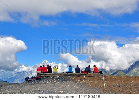 Group Of Travellers In French Alps