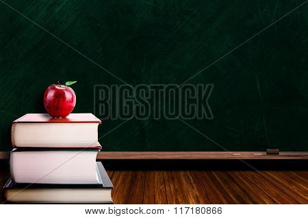 Education Concept With Apple On Books And Blackboard Background