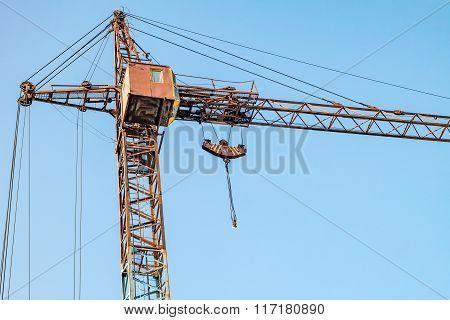 Construction. Crane. Blue sky.