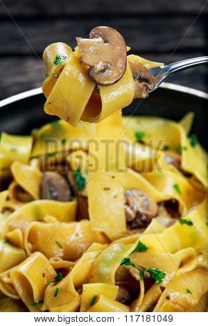 close up Pappardelle Pasta with mushrooms on fork