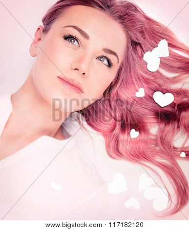 Woman fashion portrait, hair idea for Valentine's day, stylish pastel pink hair color, trendy wavy long hairstyle, beautiful model with romantic look