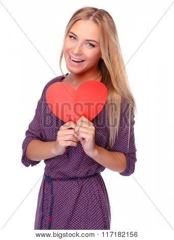 Cute cheerful girl with red paper heart in hands isolated on white background, symbol of health and love, celebrating Valentine day