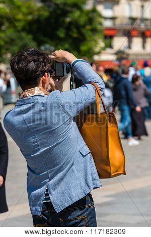 Man Taking Pictures On The Street