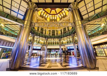 TOKYO, JAPAN - AUGUST 29, 2015: People pass through the Marunouchi ticket entrance to Tokyo Station.
