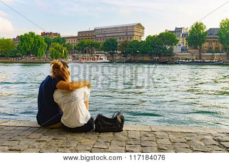 PARIS - SEP 06: people rest near Seine river on September 06, 2014 in Paris, France. Paris, aka City of Love, is a popular travel destination and a major city in Europe