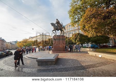Lviv, Ukraine - October 18, 2015: Citizens And Tourists In The Square Near The Monument To Daniel Of