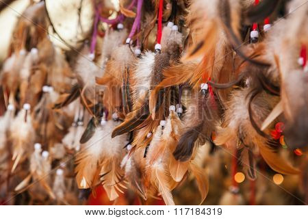 Close up of authentic dreamcatchers with feathers and beads