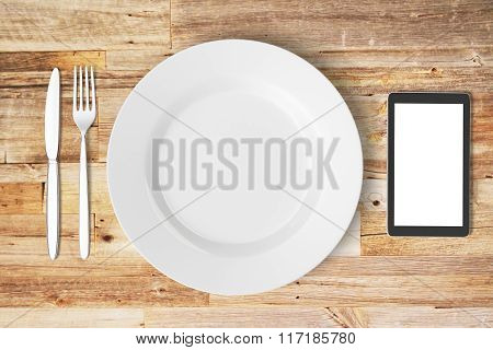 White Plate, Blank Smartphone Screen, Fork And Knife On Wooden Table, Mock Up