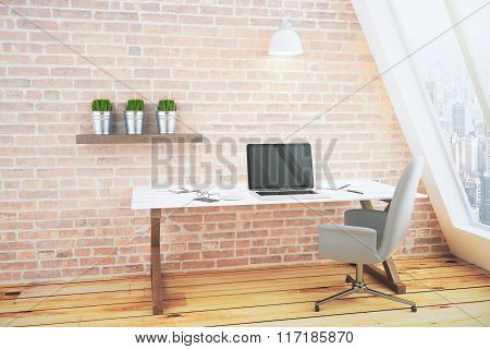 Blank Black Laptop Screen On White Wooden Table In Loft Room With Brick Wall And City View
