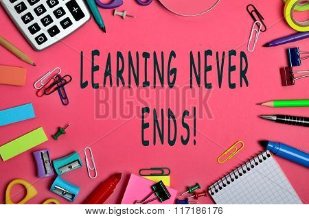 Learning never ends words on pink background