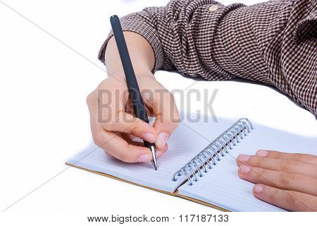 Hand writing on a notebookee