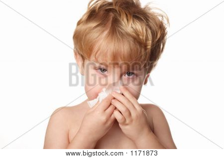 Sick Child Wiping His Nose