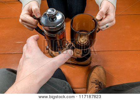 Woman Giving A Cup Of Tea To Man