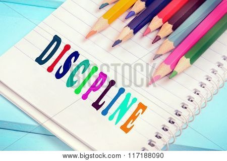 Discipline Word On Notebook
