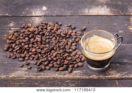 Top view of a cup of coffee on a rustic table