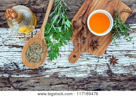 Assortment Of Herbs Rosemary ,thyme,sage And Parsley Set Up With Wooden Background Concept For Inter