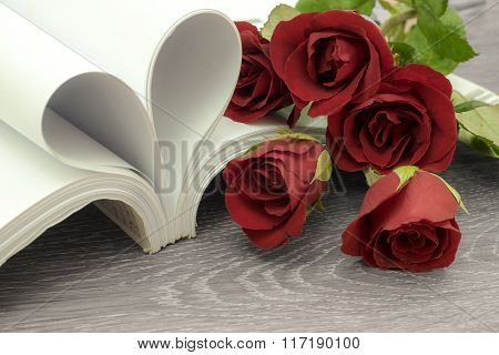heart and rose flower with book