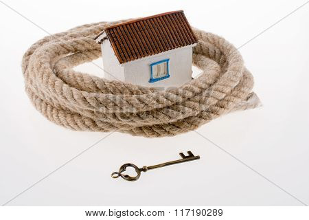 Key House Surrounded By Rope